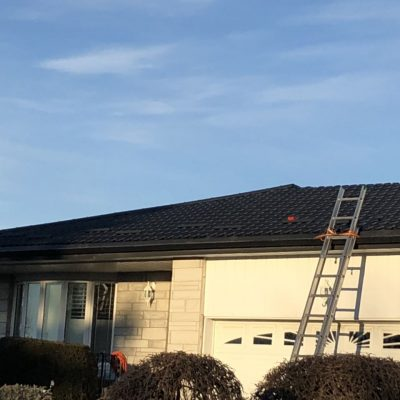 Black steel roof installation