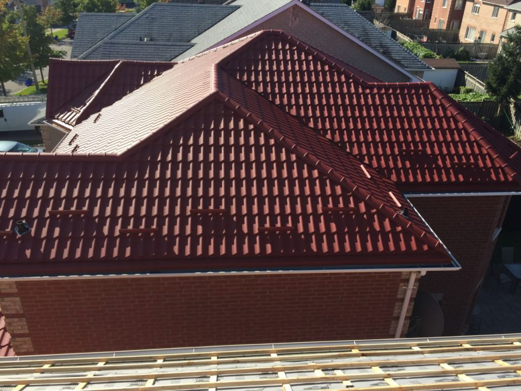 Red steel roof installed on joists