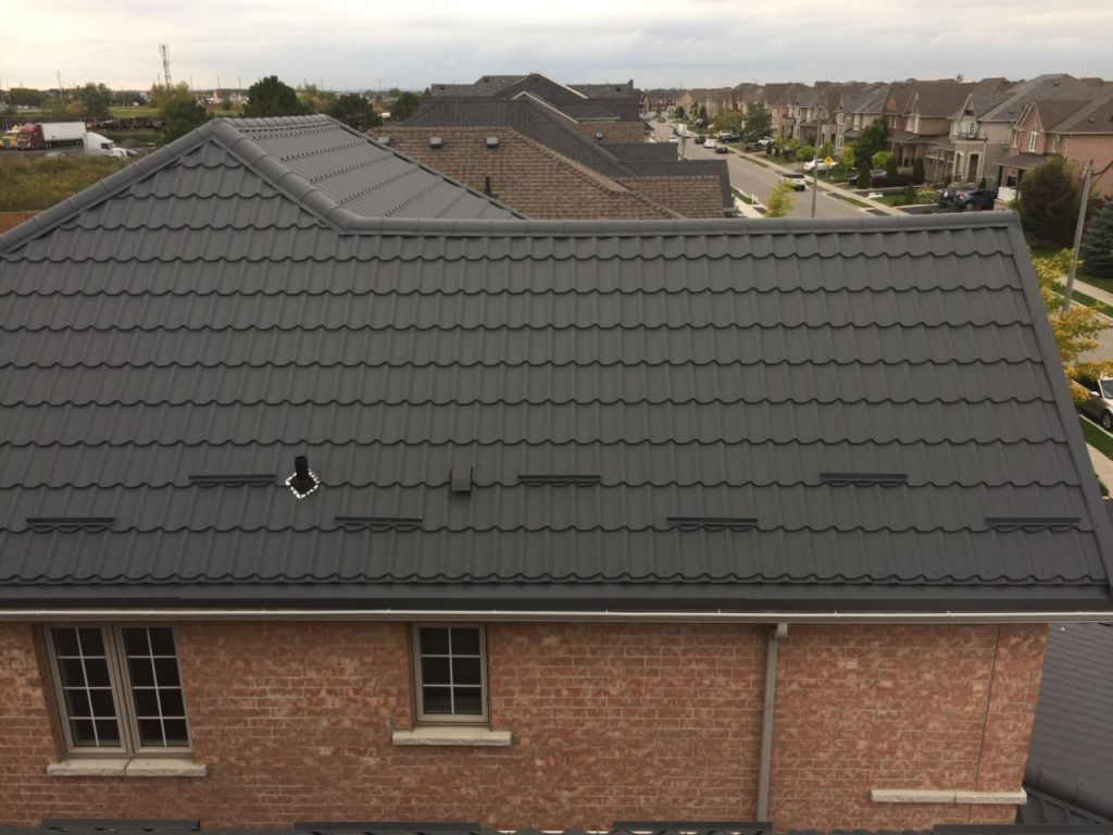 Dark metal roof with snow guards