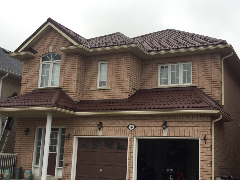 red steel roof installed on a large house