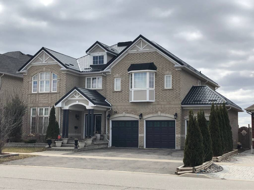 Amazing Home with Black Metal Roof by Dream Roof Contractors Scarborough
